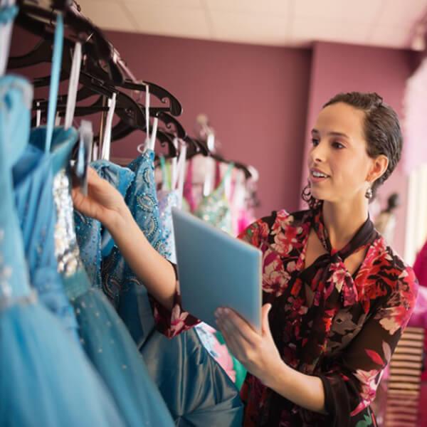 woman using iPad - fashion store